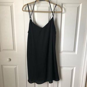 Black chiffon strapped dress.